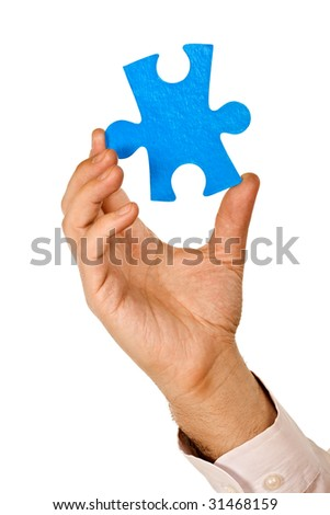 Businessman holding a piece of blue puzzle - isolated - stock photo