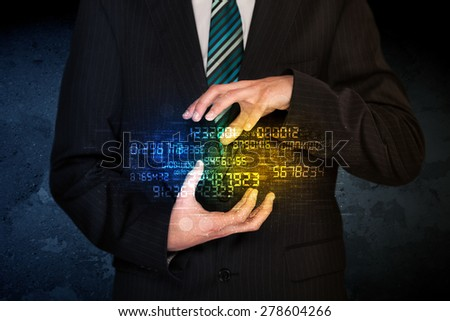 Businessman holding a shining number cloud in front of his body - stock photo