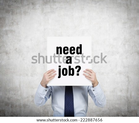 "Businessman holding a sign ""need a job""  - stock photo"