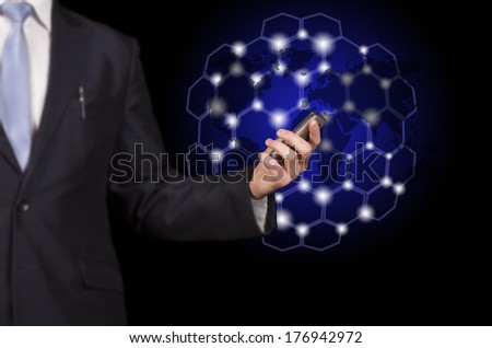 businessman holding a smartphone in hand and cellular communication in the form of a cell on a black background