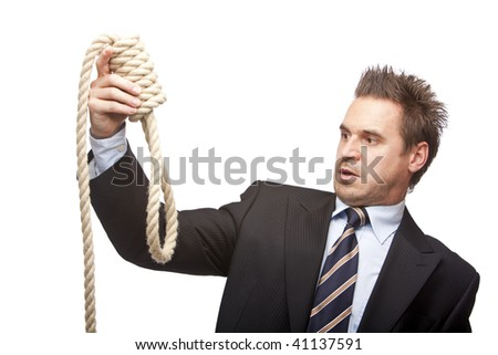 Businessman holding a suicide rope in hands and looks shocked on it. Isolated on wite background. - stock photo