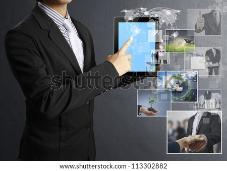 Businessman holding a tablet pc - stock photo