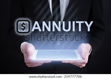 businessman holding a tablet pc with annuity text. Internet concept. business concept.  - stock photo