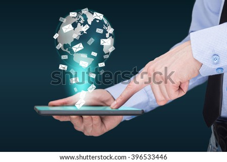 Businessman holding a tablet pc with mobile applications icons on virtual screen . Internet and business concept. message. mail. - stock photo