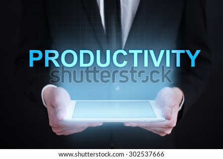 "Businessman holding a tablet pc with ""prductivity"" text on virtual screen. Business concept. Internet concept."