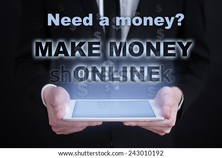 businessman holding a tablet PC with the make money button. business concept. Internet concept. Make Money Online - stock photo