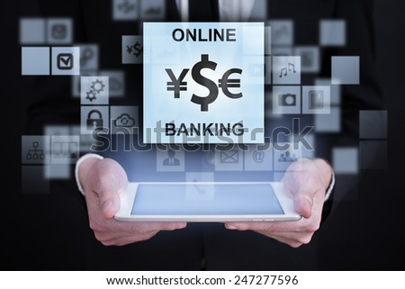 Businessman holding a tablet. with touch screen interface and internet banking icon. . internet concept. - stock photo