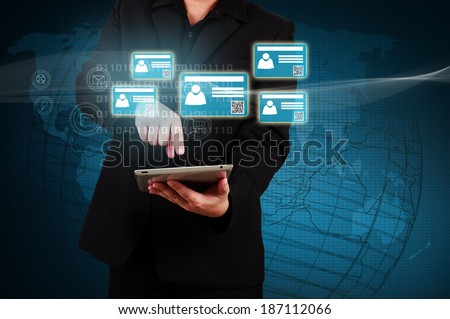 Businessman holding a tablet with virtual  card and community icons. Concept of business communication.
