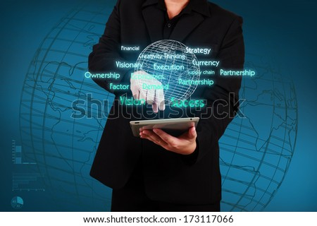 Businessman holding a tablet with virtual globe and business plan. Concept of business strategy - stock photo