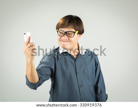 Businessman holding a telephone on a white background.