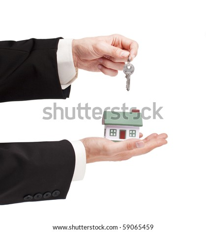 businessman holding a toy house and key, real estate presentation - stock photo
