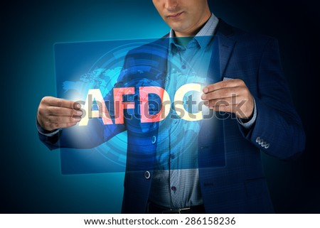 Businessman holding a transparent screen with an inscription a afdc. Business, technology, internet and networking concept. - stock photo