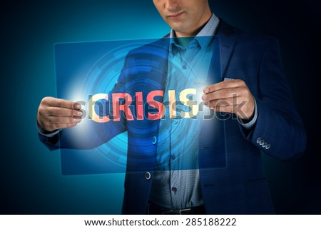 Businessman holding a transparent screen with an inscription a crisis. Business, technology, internet and networking concept. - stock photo