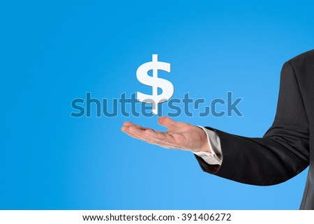 Businessman holding a virtual infographics in his hand, in front of a blue background