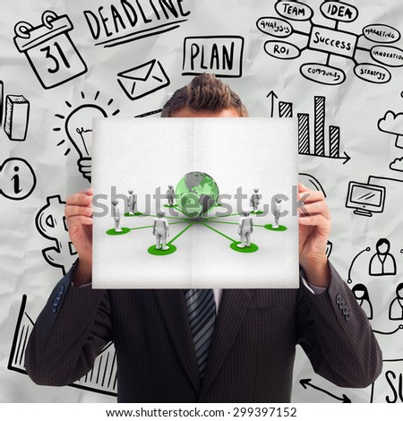 Businessman holding a white card in front of his face against 3d men connected with earth - stock photo
