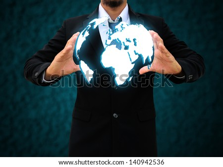 businessman  holding a world