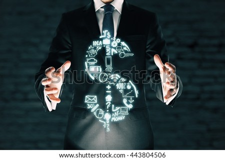 Businessman holding abstract business chart dollar sign on brick background. Financial growth concept