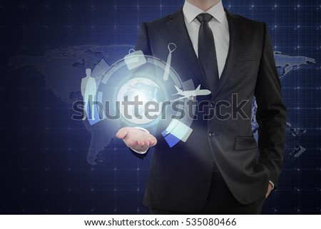 Businessman holding abstract digital button with work, travel and other icons on map background. Technology in everyday life concept