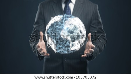 businessman holding an abstract Earth