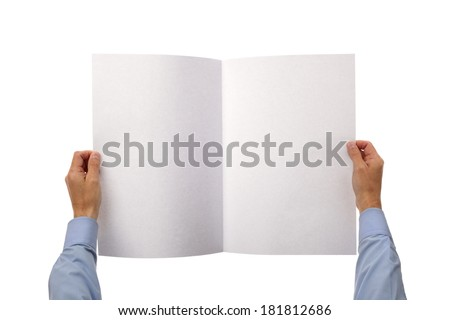 Businessman holding and reading a blank newspaper with copy space from above - stock photo