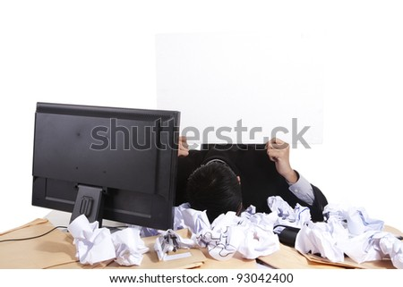 Businessman holding and showing a blank board in his office - stock photo