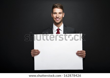 businessman holding banner with copy space - stock photo
