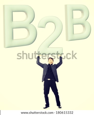 Businessman holding big 2 from B2B sign. - stock photo
