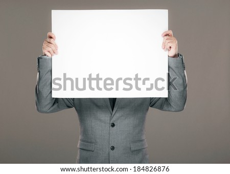 Businessman holding billboard