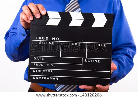 Businessman holding blank black film clapper board, isolated on white background. - stock photo
