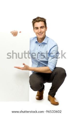 Businessman holding blank board - stock photo