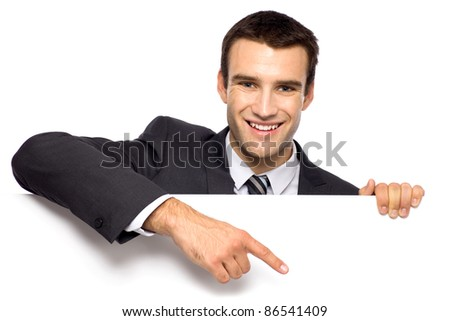 Businessman holding blank poster
