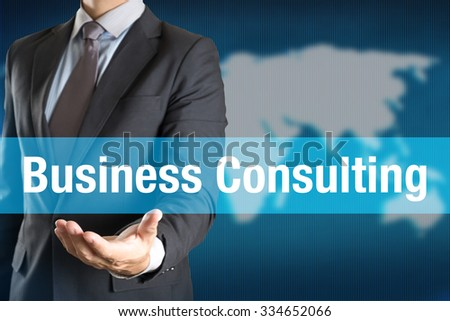 Businessman holding Business Consulting word with world background - stock photo