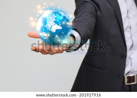 businessman holding business world.