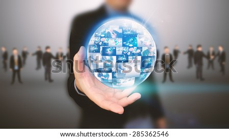 Businessman holding business world with team.