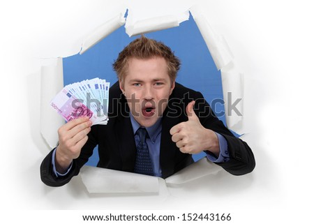 businessman holding cash - stock photo