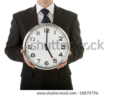 Businessman Holding Clock