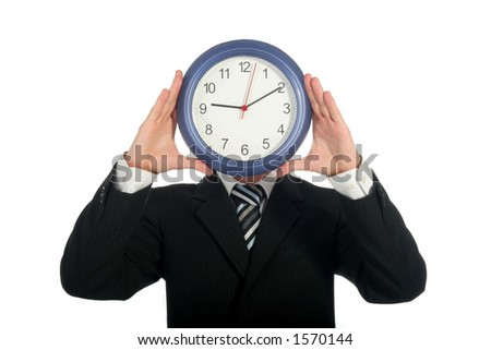 Businessman holding clock in front of his face