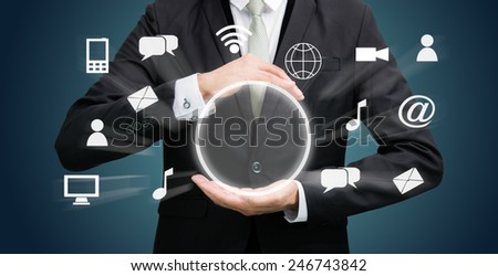 Businessman holding cloud computing network on dark background