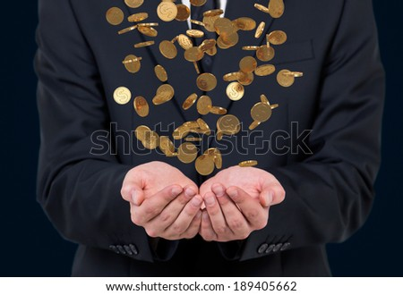 Businessman holding coins - stock photo