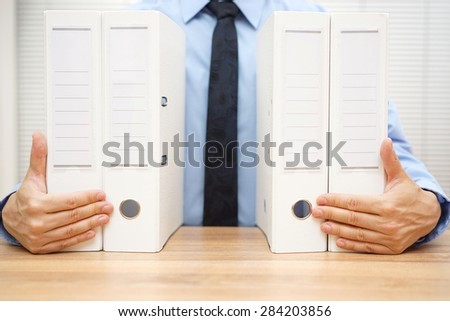 businessman holding company documentation, accounting concept - stock photo