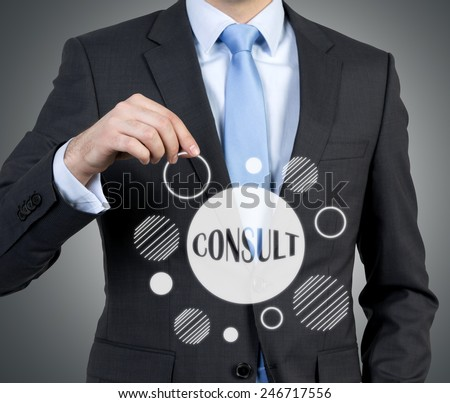 businessman holding consult scheme on a gray background - stock photo