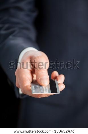 Businessman holding credit card - stock photo