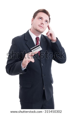 Businessman holding credit card and thinking at costs isolated on white studio background