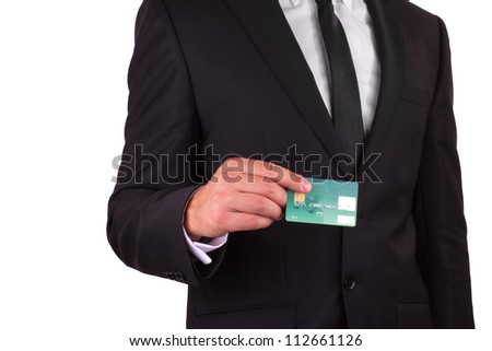 Businessman holding credit card, isolated on white background - stock photo