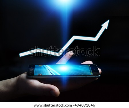 Businessman holding digital arrow over his mobile phone 3D rendering