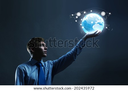 Businessman holding digital Earth planet in hand - stock photo