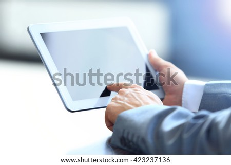 Businessman holding digital tablet - stock photo
