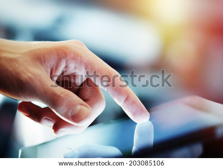 businessman holding digital tablet, closeup - stock photo