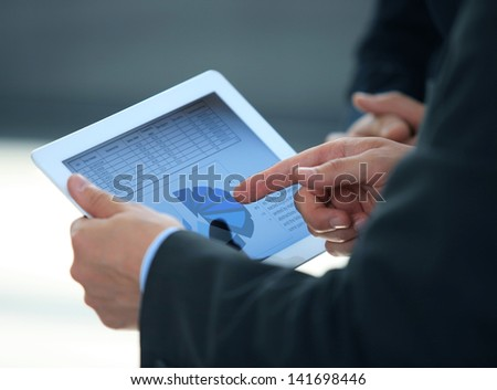 businessman holding digital tablet in office - stock photo