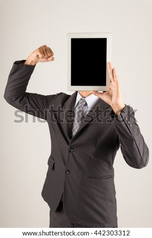 Businessman Holding Digital Tablet pc, show on face position, strong action - stock photo